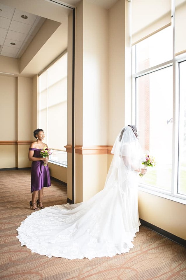 photo of wedding bride and bridesmaid in cross insurance center