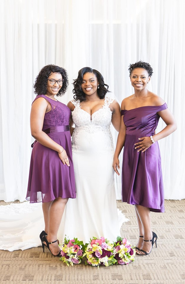 photo of wedding bride and bridesmaids in cross insurance center