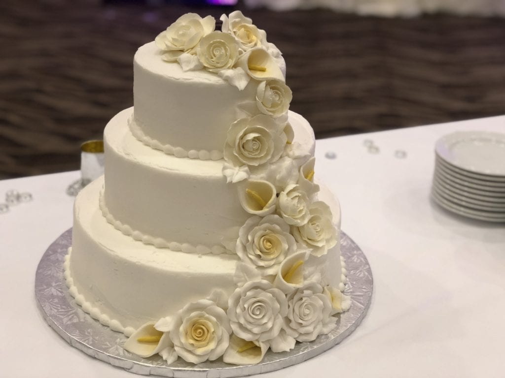 photo of wedding cake in cross insurance center ballroom