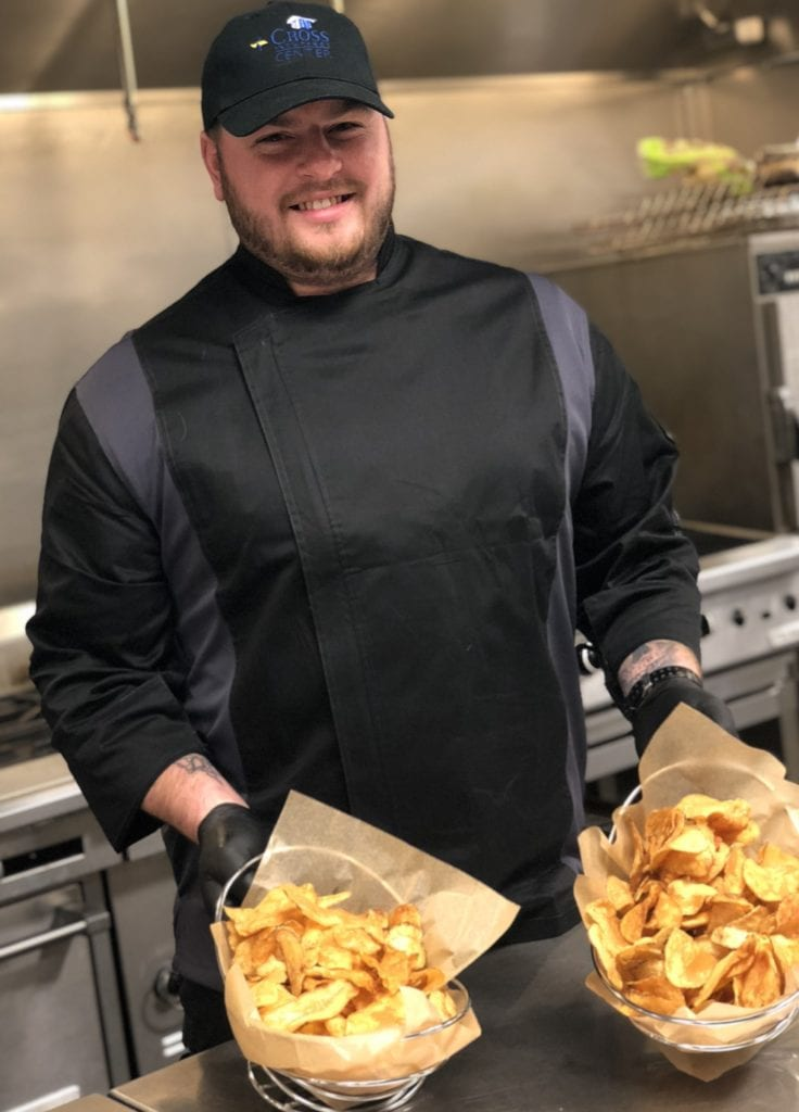 photo of ryan holding baskets of home made chips